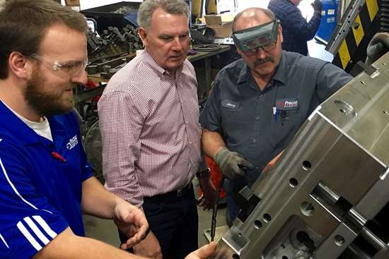 Don Dumoulin of Precise Tooling Solutions looks at a mold
