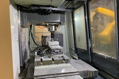 A push pad in the toolchanger ensures the part is fully seated in the jaws