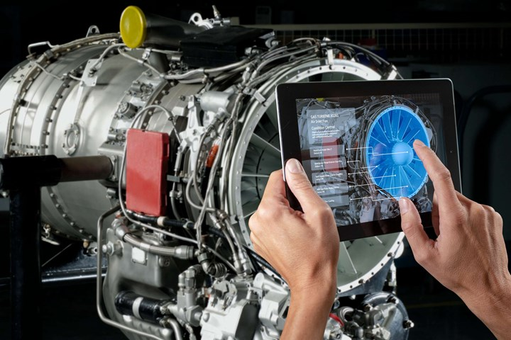 Hands hold up a tablet leveraging a 5G connection and augmented reality to provide essentially X-ray vision revealing the internals of a complex turbine assembly.