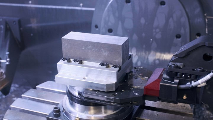 A workpiece blank is fixtured on a pallet and ready for transfer from robot to machining center at Prosper-Tech Machine & Tool.