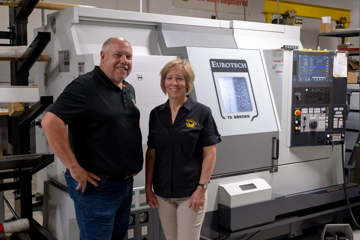 Heidi and Bob Devroy stand in front of one of the newest machine tools (a live-tool lathe) on the shop floor of the company they founded in 2007, Prosper-Tech.