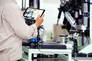 worker looking at a tablet