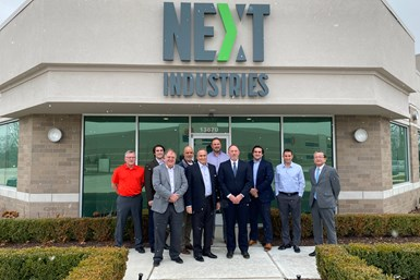 A photo of Next Industries and Kitamura management in front of Next Industries' headquarters