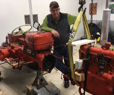 Don Snow with antique tractor