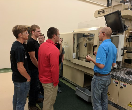 Students learn about molding quality parts at Plastikos on MFG Day 2017.