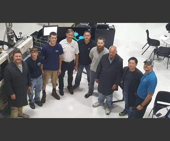 Group at RJG Inc. readies for injection mold tryout.