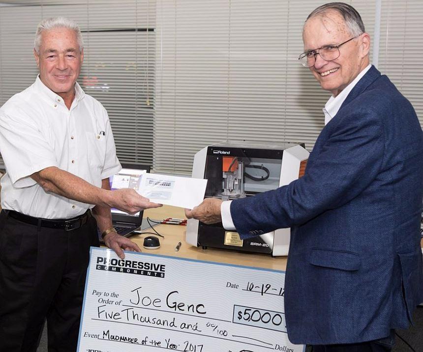 AMBA Moldmaker of the Year Joe Genc presents $5,000 check to AMBA Chicago Chapter President Chuck Klingler.