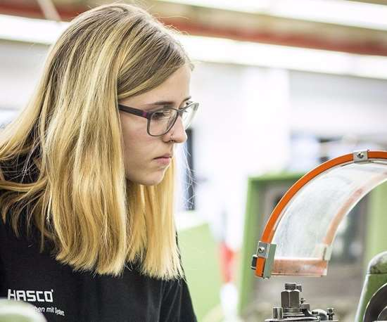 Student performs precision metalworking