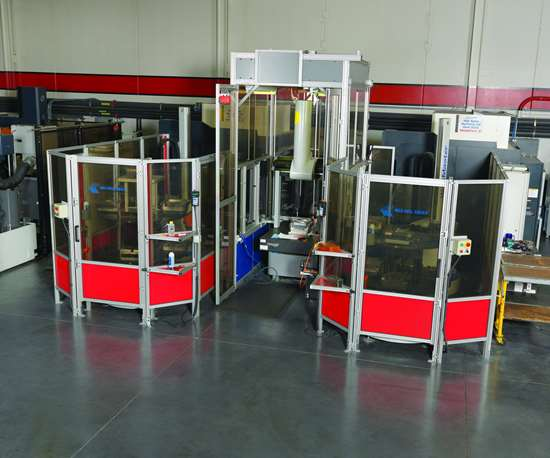 An automated hard milling cell featuring two vertical machining centers tied to a common coordinate measuring machine