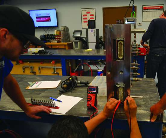 Moldmakers working on hot runner system