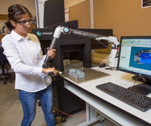 Student works with Hexagon Manufacturing Intelligence Romer Absolute arm