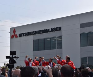 Company leaders and visitors lift cups of sake in celebration of MC Machinery opening new headquarters.
