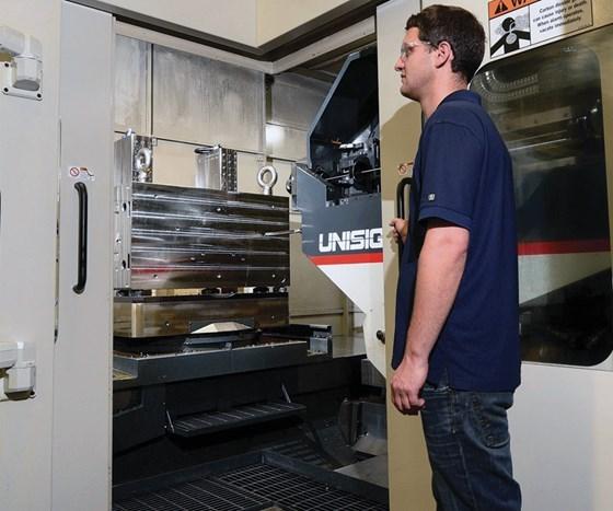 Worker stands near Ingersoll Cutting Tool's Deep Trio