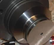astandard cooling bushing is used to isolate the nozzle tip from the aluminum tool
