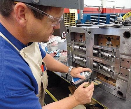 Worker partially disassembles mold