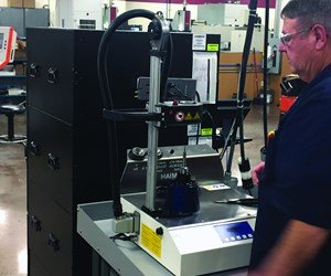 A Custom Mold and Design employee uses the Haimer Power Clamp Mini shrink-fit system