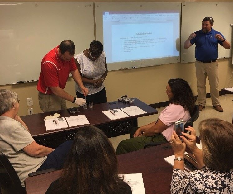 Teachers learn about plastics at RJG Inc.