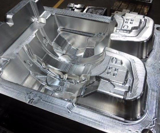 Block of 7000 series Alumold that produced wheel-well liner for Honda Civic.