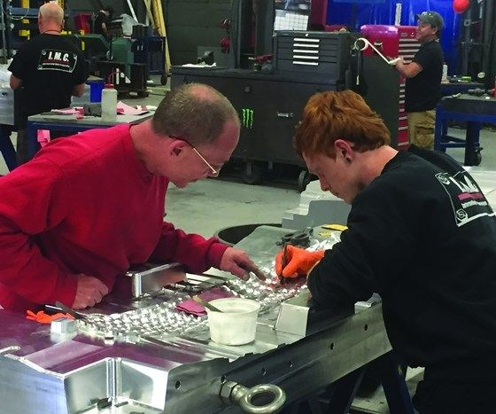 Apprentice learning to polish an injection mold.