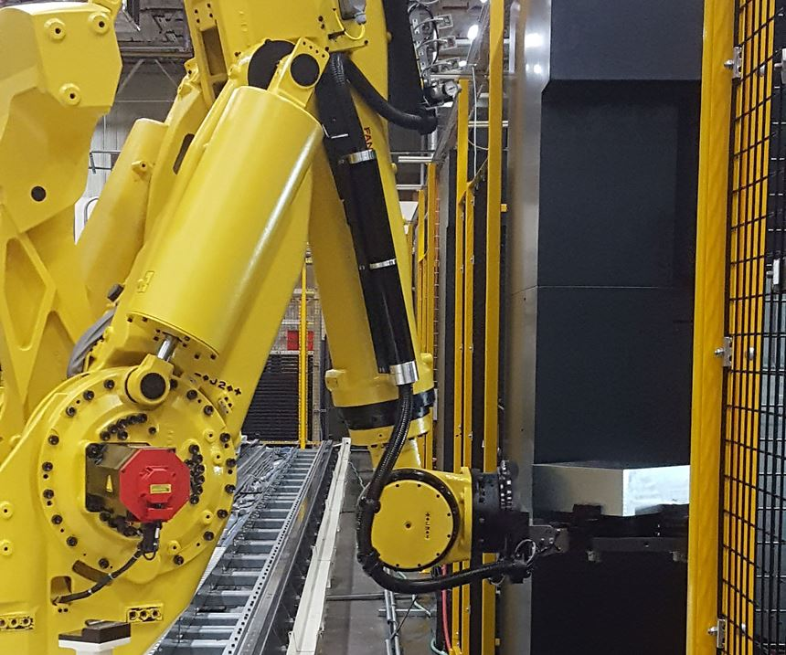 FANUC robot feeding a CNC machine at Cooper Tires