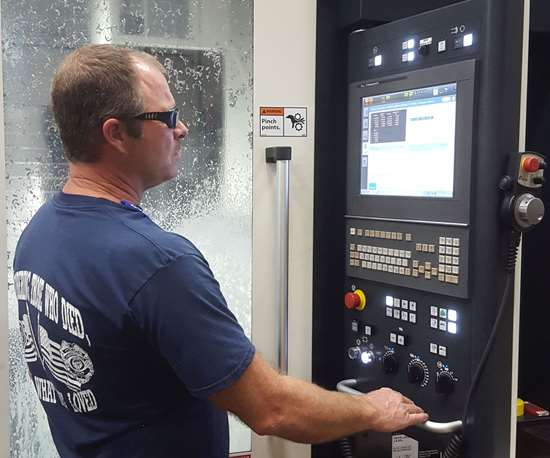 Cooper Tire CNC machinist at Makino PRO6 control