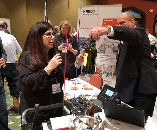 Raffle prize drawing during the AMBA Chicago's Supplier Night event.