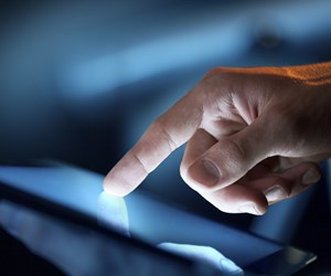 Hand touching tablet screen with index finger