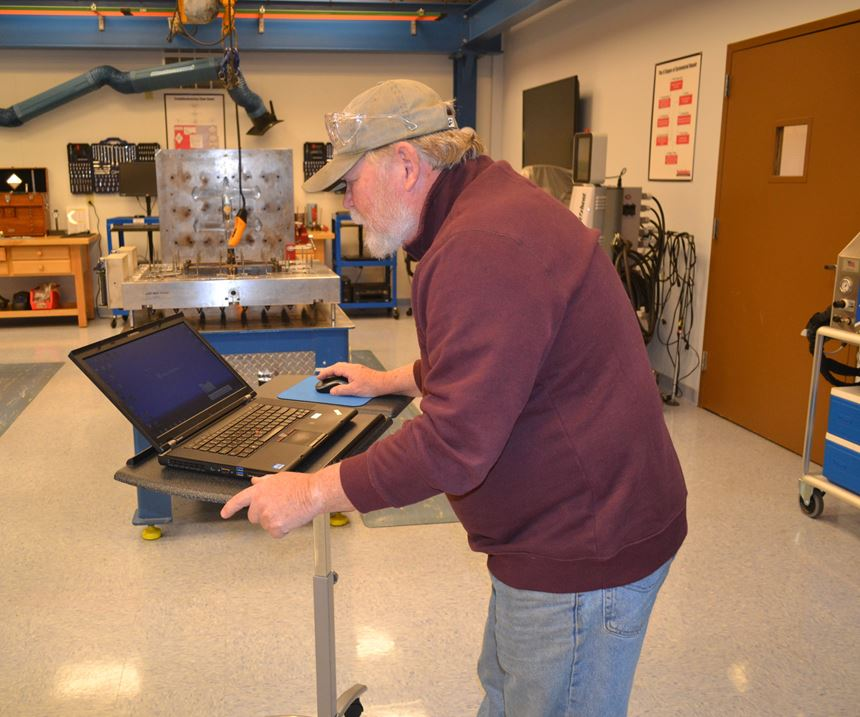 mobile stand that forces worker to hunch over to use
