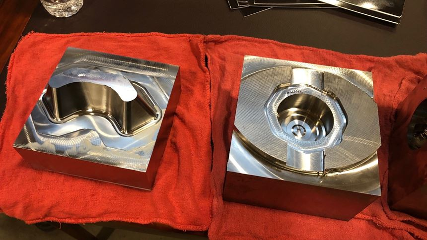 Two workpieces, made of 15-5 PH stainless steel after being machined at Toyoda Americas Corp. during a demonstration of cutting tools from Tungaloy