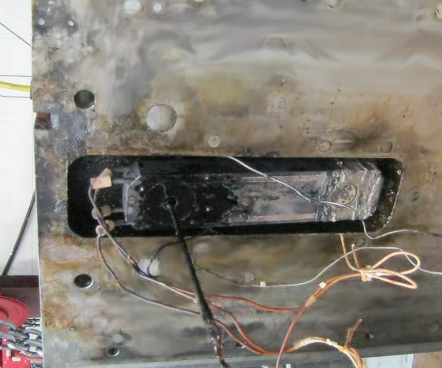 Damaged mold from fluid leak.
