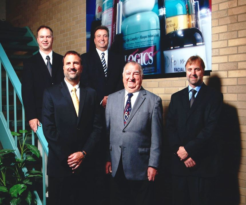 Joe Prischak (second from the right) and others at the Plastek Group