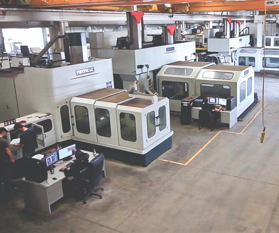 Integrity Tool's facility shop floor housing several machine tools.