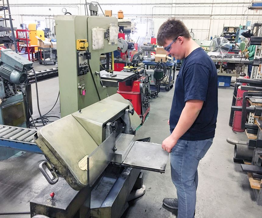 Sean Willard cuts stock for a new project on a bandsaw