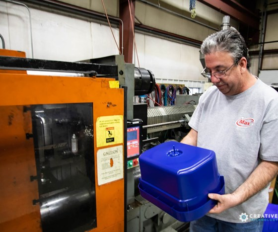 Worker sampling molds at Max 3 in Benton Harbor, Michigan