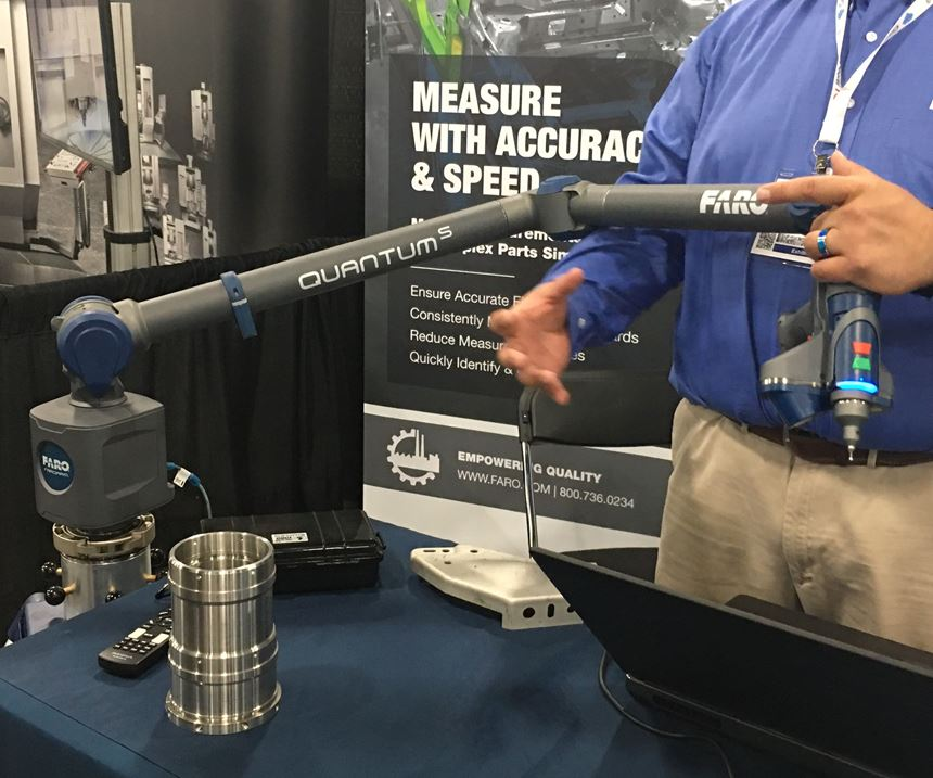 Booth exhibitor showing the Faro Quantum S 3D Scan Arm