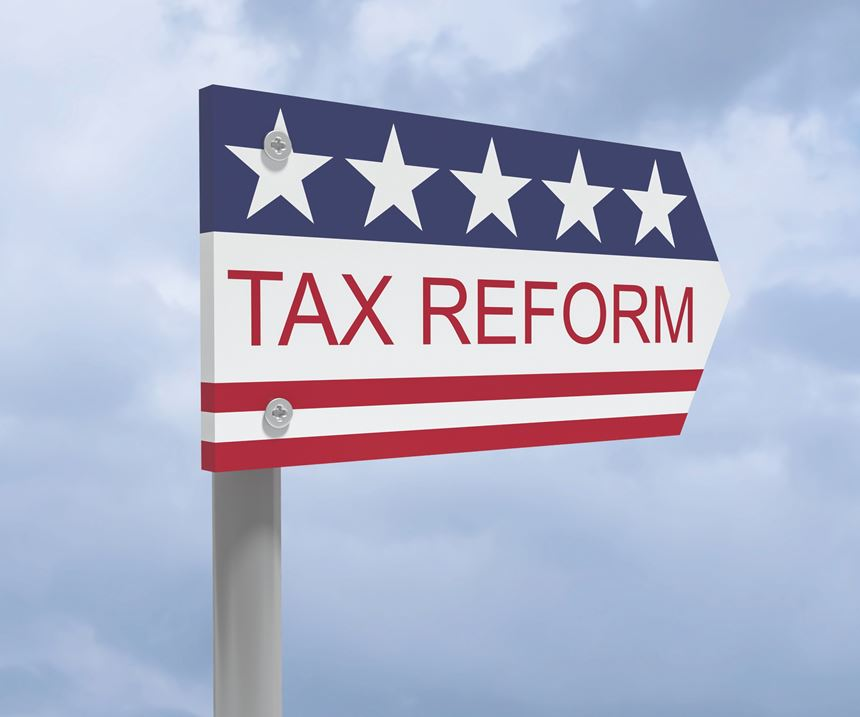 red, white and blue tax reform sign with a cloudy sky in the background