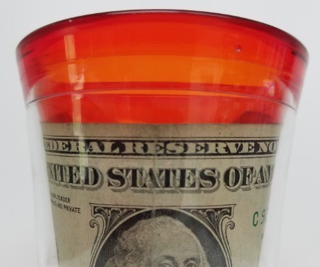 plastic up with a dollar bill sealed in