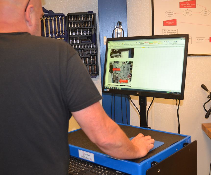man at computer on cart