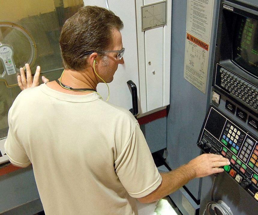 machinist using software at machine
