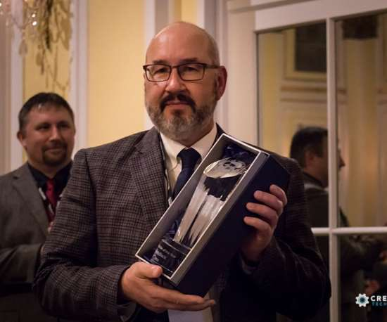 man holding award