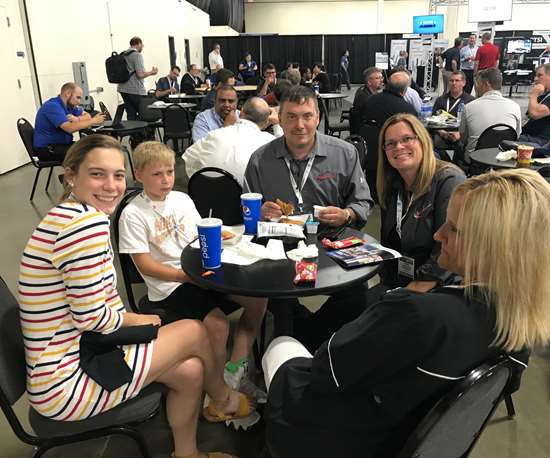 Maximum Mold owner and family members in seating area at Amerimold 2018