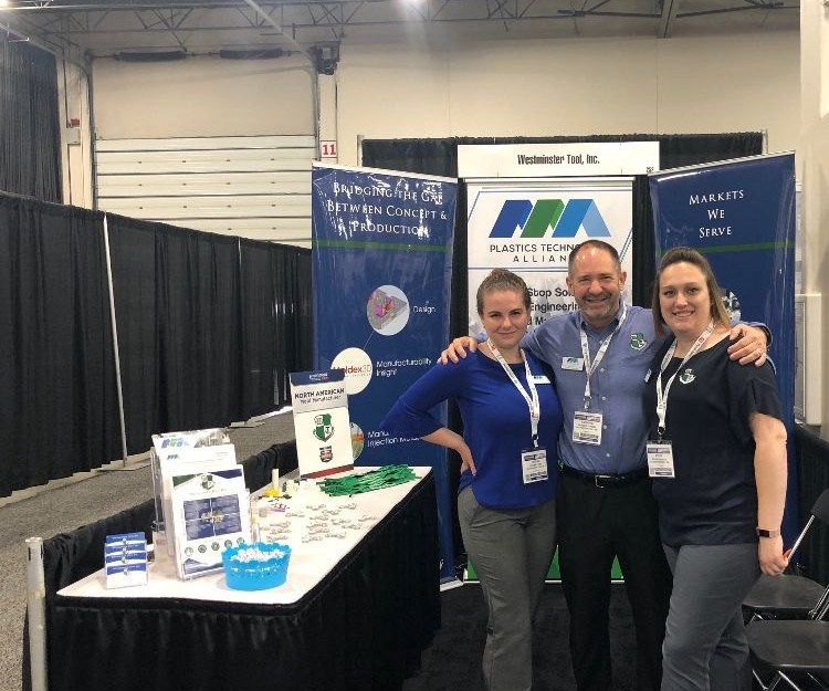 Ray Coombs, Kylee Carbone and another employee of Westminster Tool at Amerimold 2018 booth