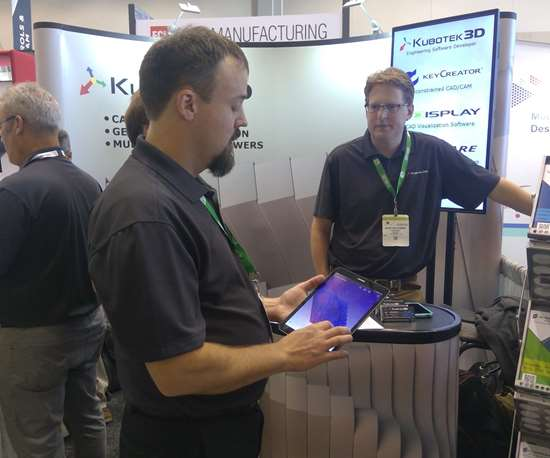 Kubotek representative holding a tablet with Kubotek3D at IMTS 2018