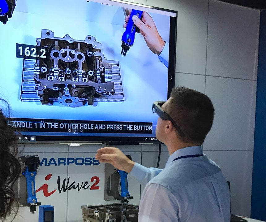 IMTS attendee participating in Marposs augmented reality simulation on iWave2
