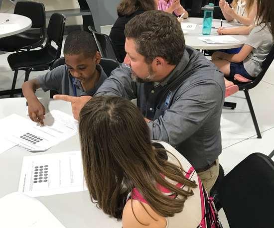 RJG representative teaching kids