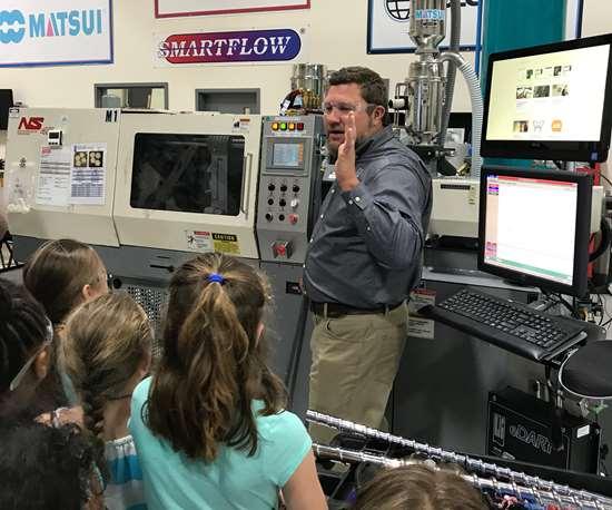 RJG representative talking to kids about machinery