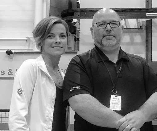 Christina Fuges and Greg Eidenberger standing