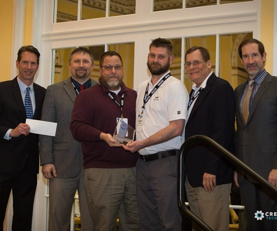 MSI Mold Builders receives Tooling Trailblazer award and scholarship check at AMBA conference.