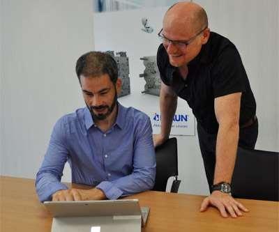 two men at laptop