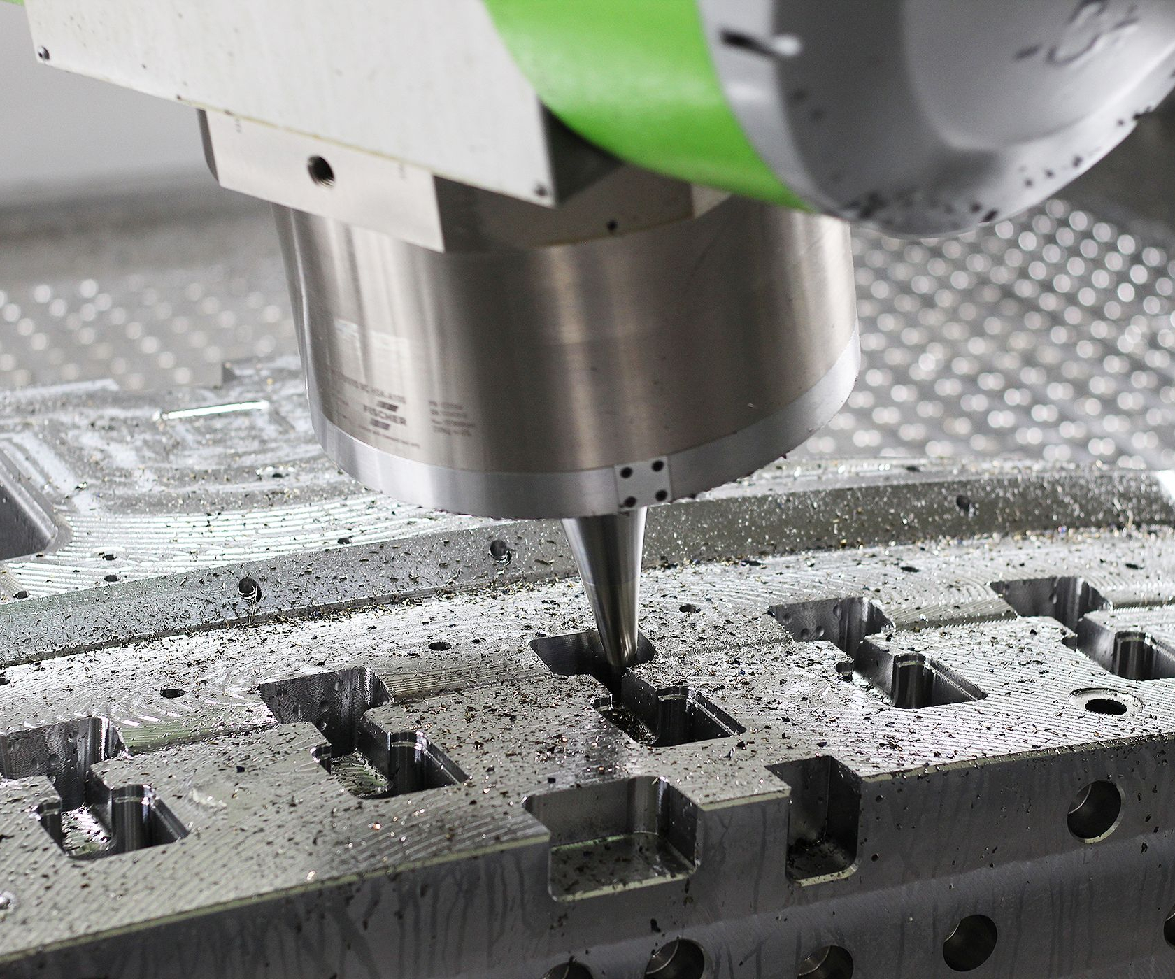 people in front of milling machine